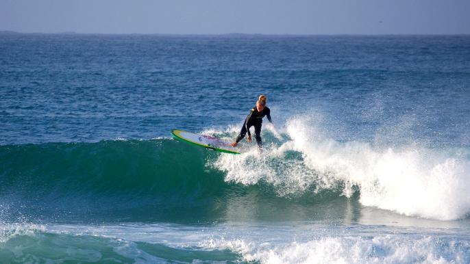 onbeperkt 25% korting op een beginnersles surfen